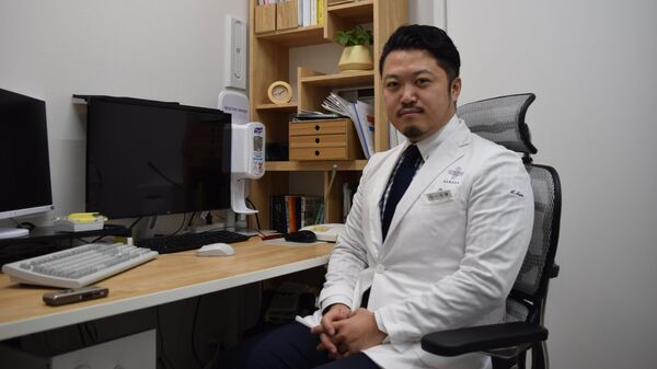 Врач-инфекционист и эпидемиолог Сато Акихиро