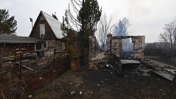 Пепелище на месте дачного дома в Новосибирской области