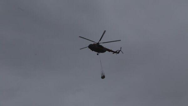 Сотрудники МЧС во время ликвидации последствий ЧС в Норильске