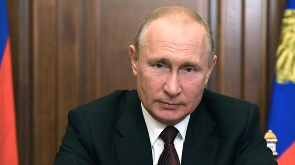Президент России Владимир Путин во время обращения к гражданам России