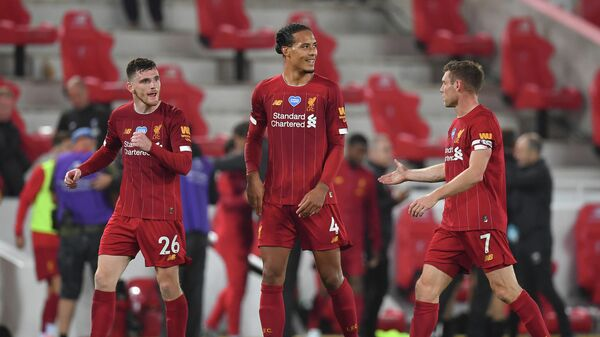Liverpool's Scottish defender Andrew Robertson (L), Liverpool's Dutch defender Virgil van Dijk (C) and Liverpool's English midfielder James Milner react after the English Premier League football match between Liverpool and Chelsea at Anfield in Liverpool, north west England on July 22, 2020. - Liverpool won the match 5-3. (Photo by Paul ELLIS / POOL / AFP) / RESTRICTED TO EDITORIAL USE. No use with unauthorized audio, video, data, fixture lists, club/league logos or 'live' services. Online in-match use limited to 120 images. An additional 40 images may be used in extra time. No video emulation. Social media in-match use limited to 120 images. An additional 40 images may be used in extra time. No use in betting publications, games or single club/league/player publications. /