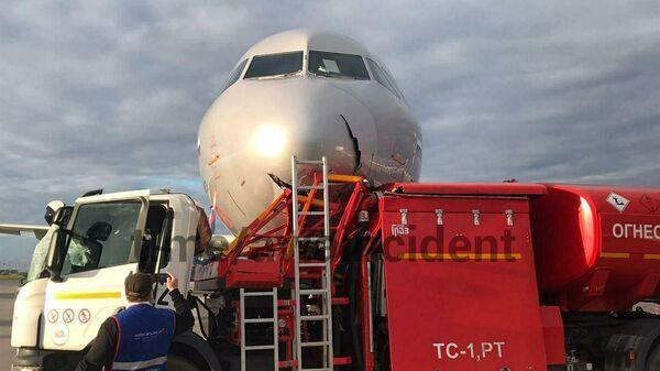 Последствия столкновения самолета с бензовозом в аэропорту Шереметьево