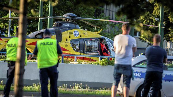 Вертолет скоро помощи возле места падения Фабио Якобсена