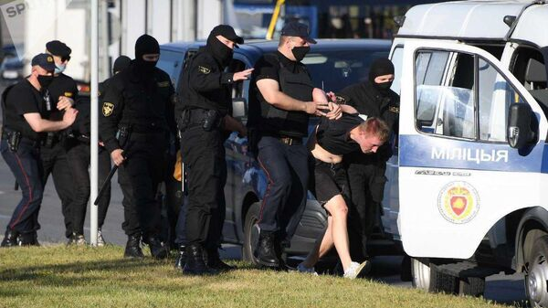 Сотрудники милиции во время задержания в Минске