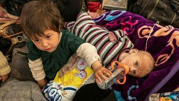 Дети в лагере Эль-Холь на севере Сирии