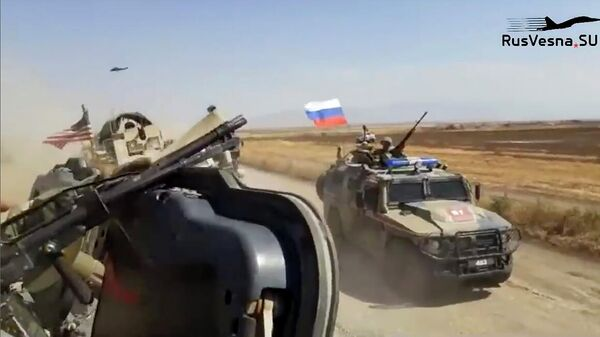 Кадр видео инцидента с участием российского патруля и военных США в Сирии, опубликованного сайтом Русская весна