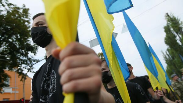 Участники Марша защитников Украины во время акции в рамках празднования Дня независимости страны в Киеве
