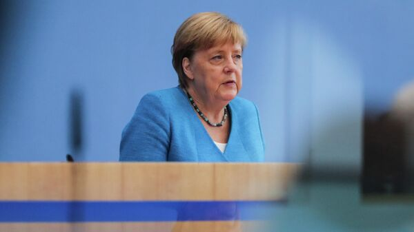 Ангела Меркель во время пресс-конференции в Берлине