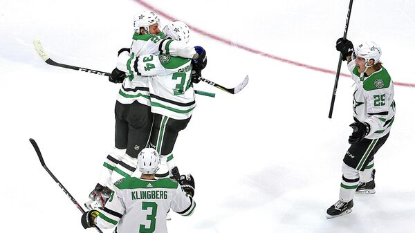 EDMONTON, ALBERTA - SEPTEMBER 14: Denis Gurianov #34 of the Dallas Stars is congratulated by his teammates after scoring the game-winning goal against the Vegas Golden Knights during the first overtime period to win Game Five of the Western Conference Final during the 2020 NHL Stanley Cup Playoffs at Rogers Place on September 14, 2020 in Edmonton, Alberta, Canada.   Bruce Bennett/Getty Images/AFP