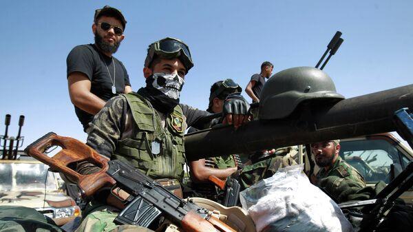 Военнослужащие ливийской национальной армии (ЛНА) на передовой к западу от города Сирт