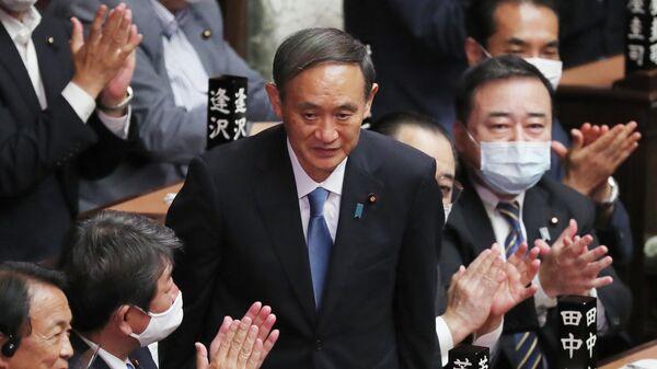Есихидэ Суга в нижней палате парламента после избрания новым премьер-министром Японии