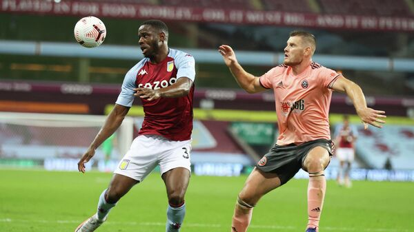 Soccer Football - Premier League - Aston Villa v Sheffield United - Villa Park, Birmingham, Britain - September 21, 2020 Aston Villa's Keinan Davis in action with Sheffield United's Jack O'Connell Pool via REUTERS/Julian Finney EDITORIAL USE ONLY. No use with unauthorized audio, video, data, fixture lists, club/league logos or 'live' services. Online in-match use limited to 75 images, no video emulation. No use in betting, games or single club/league/player publications.  Please contact your account representative for further details.