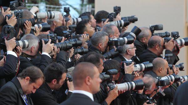 Фотокорреспонденты работают на Красной дорожке