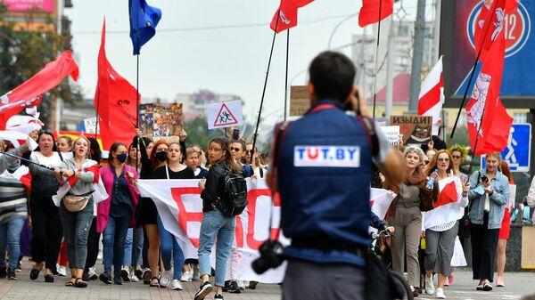 Фотокорреспондент Tut.by во время протестной акции в Минске