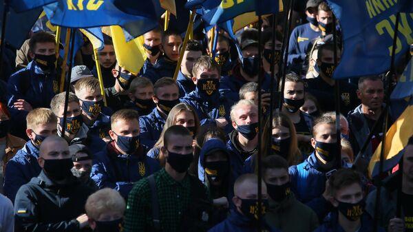 Участники Марши националистов в Киеве в честь создания Украинской повстанческой армии