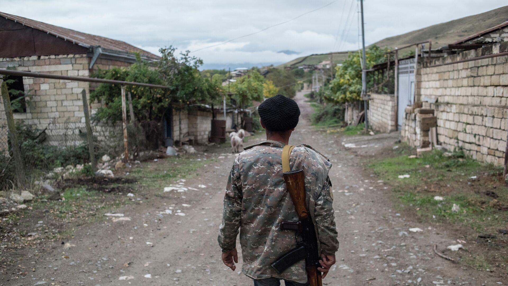 Местный житель в поселке Храморт в Нагорном Карабахе - РИА Новости, 1920, 23.10.2020