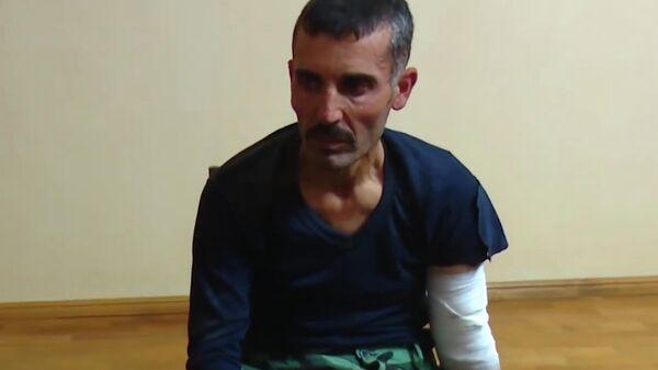Взятый в плен сириец, который участвовал в боевых действиях на стороне Азербайджана. Стоп-кадр видео
