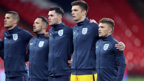 England captain Kieran Trippier (R) sings the national anthem with team mates during the international friendly football match between England and Wales at Wembley stadium in north London on October 8, 2020. (Photo by CARL RECINE / POOL / AFP) / NOT FOR MARKETING OR ADVERTISING USE / RESTRICTED TO EDITORIAL USE