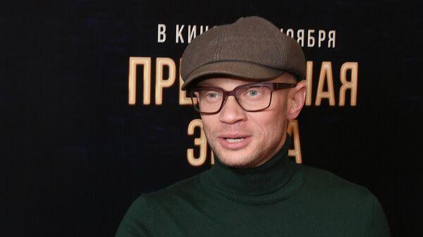 Телеведущий Дмитрий Хрусталев