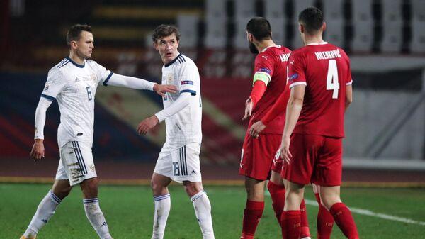 Футболисты сборной России Денис Черышев и Юрий Жирков (слева направо)