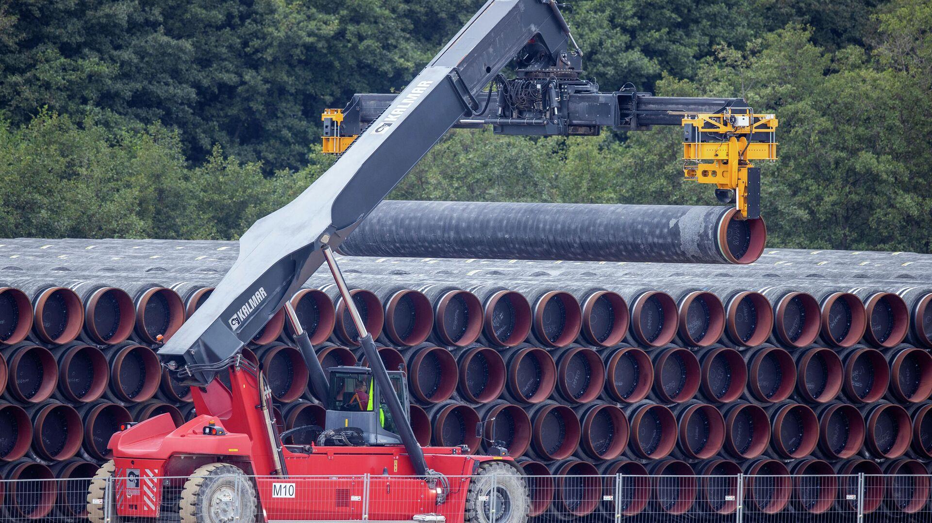 Трубы для строительства газопровода Nord Stream 2 на площадке в порту Мукран, Германия - РИА Новости, 1920, 24.01.2021