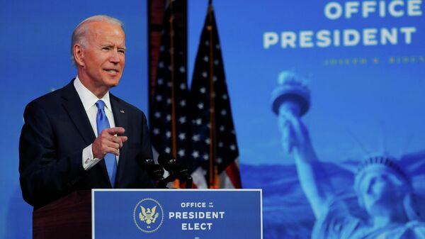 Избранный президент США Джо Байден выступает с телеобращением к нации после того, как Коллегия выборщиков США официально подтвердила его победу на президентских выборах