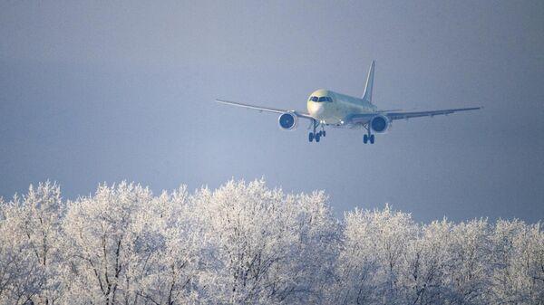 Самолет МС-21-310, оснащенный новыми российскими двигателями ПД-14, совершает посадку на аэродроме Иркутского авиационного завода