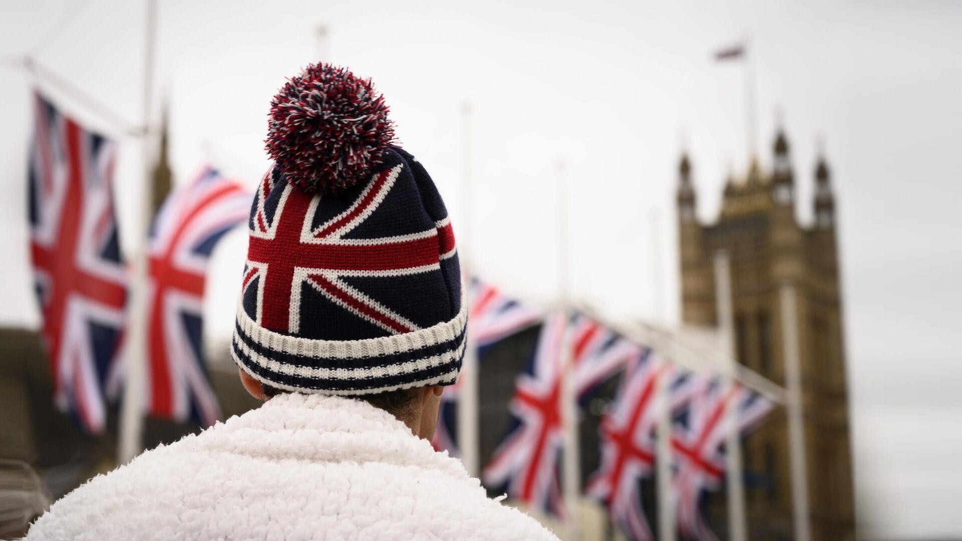 Сторонник Brexit на торжественных мероприятиях, посвященных выходу Великобритании из ЕС (Brexit Party) на площади Парламента в Лондоне - РИА Новости, 1920, 23.07.2020