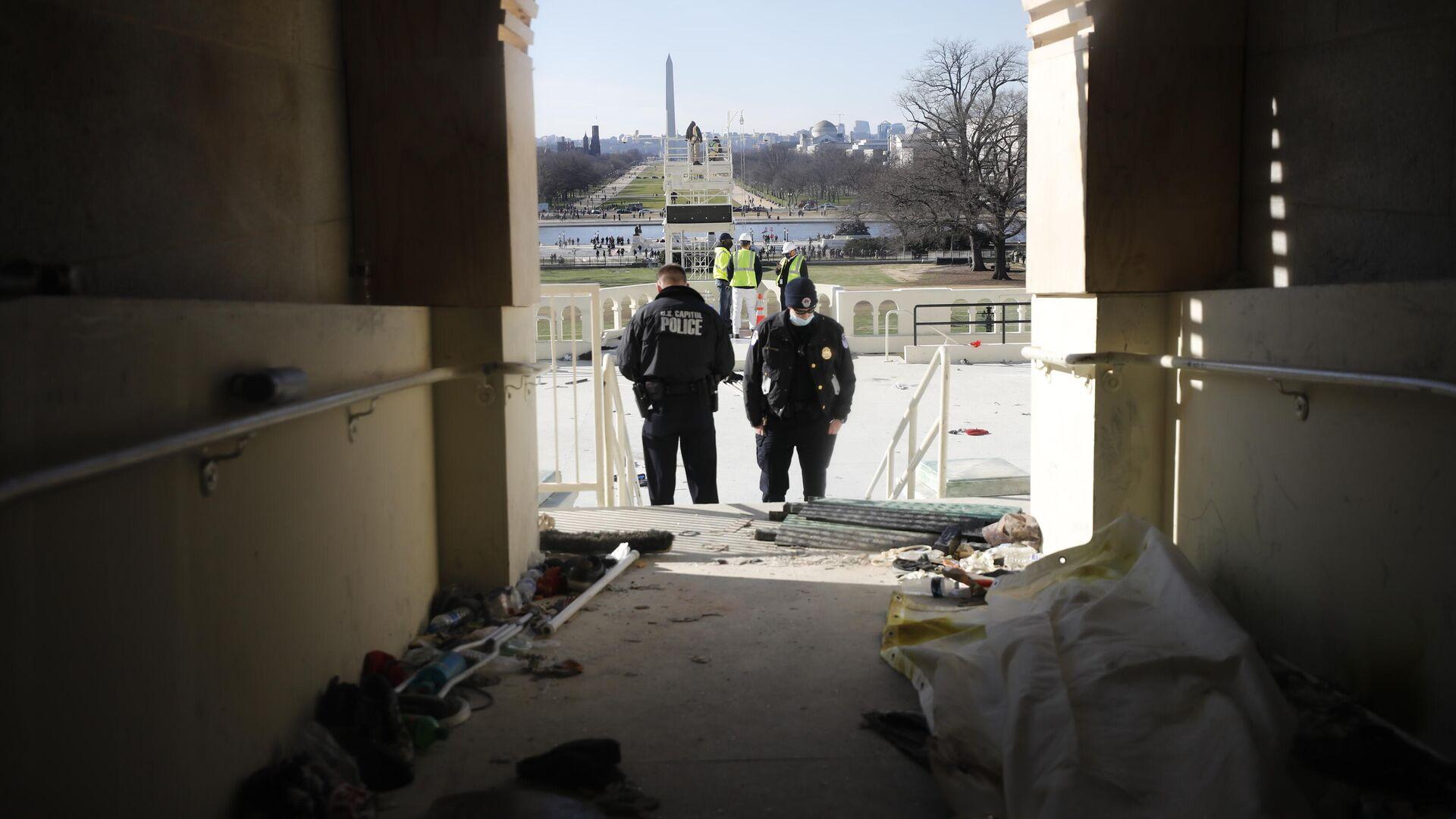 Последствия штурма Капитолия (здания Конгресса США) сторонниками Дональда Трампа на Капитолийском холме в Вашингтоне - РИА Новости, 1920, 19.07.2021