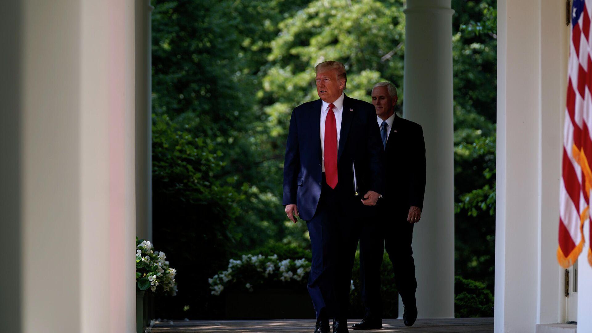 Президент США Дональд Трамп и вице-президент Майк Пенс - РИА Новости, 1920, 07.04.2021