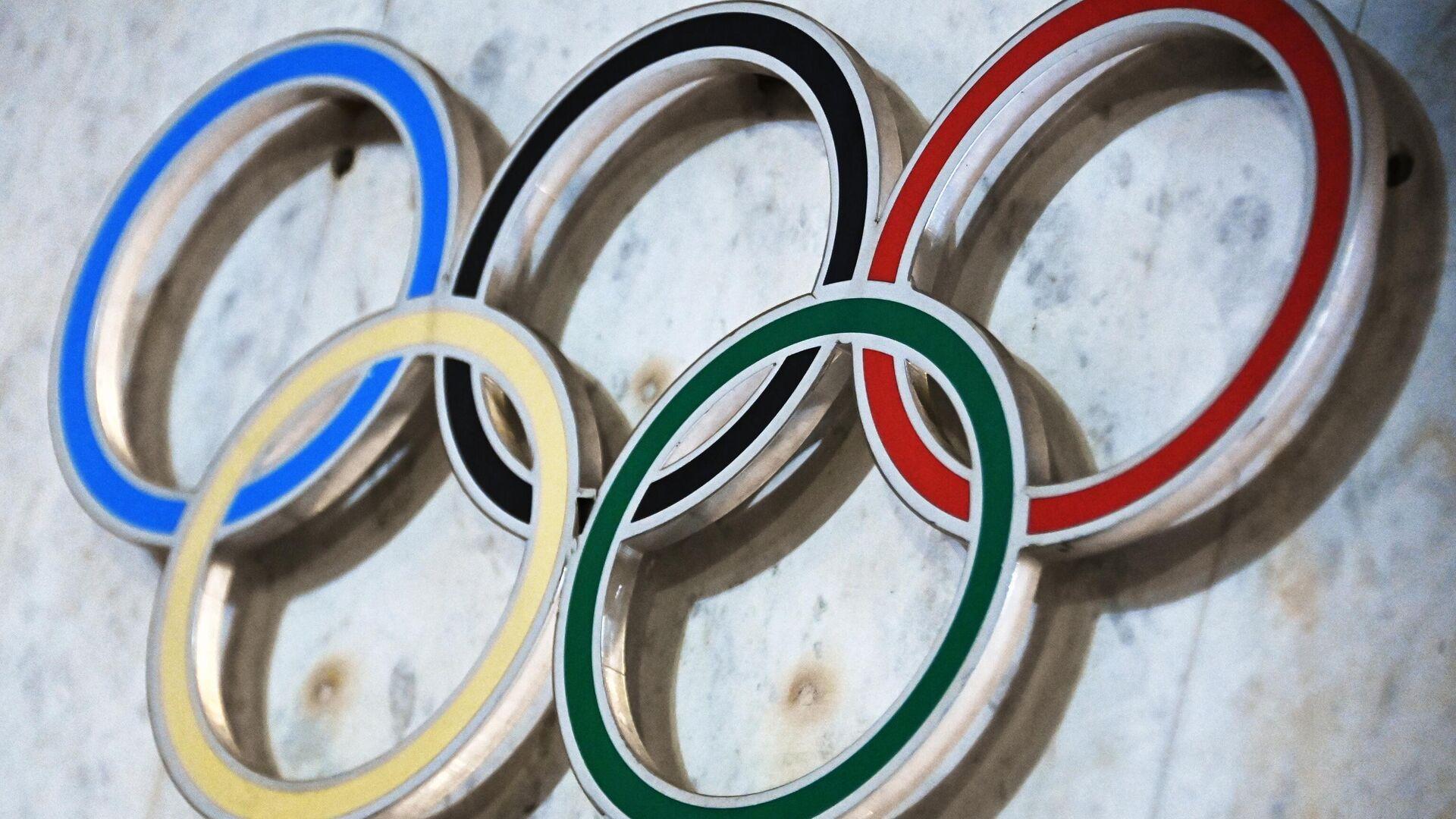 Симворика на здании Олимпийского комитета России (ОКР) на Лужнецкой набережной - РИА Новости, 1920, 05.07.2021
