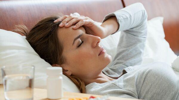 Женщина, заболевшая гриппом