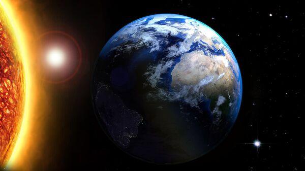 Солнце и планета Земля
