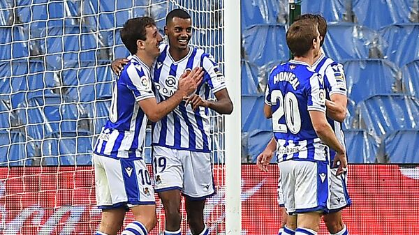 Real Sociedad's Swedish forward Alexander Isak (2L) celebrates his third goal during the Spanish league football match between Real Sociedad and Deportivo Alaves at the Anoeta stadium in San Sebastian on February 21, 2021. (Photo by ANDER GILLENEA / AFP)