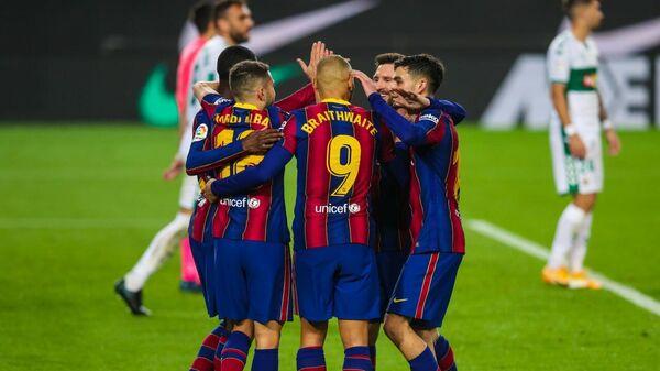 Футболисты Барселоны в матче Примеры