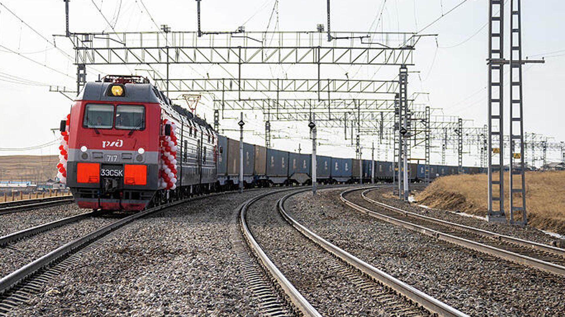 РЖД завершили электрификацию последнего участка железной дороги до границы с Китаем - РИА Новости, 1920, 26.07.2021