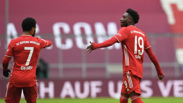 Soccer Football - Bundesliga - Bayern Munich v VfB Stuttgart - Allianz Arena, Munich, Germany - March 20, 2021 Bayern Munich's Alphonso Davies walks past Serge Gnabry as he leaves the pitch after being sent off Pool via REUTERS/Andreas Gebert DFL regulations prohibit any use of photographs as image sequences and/or quasi-video.