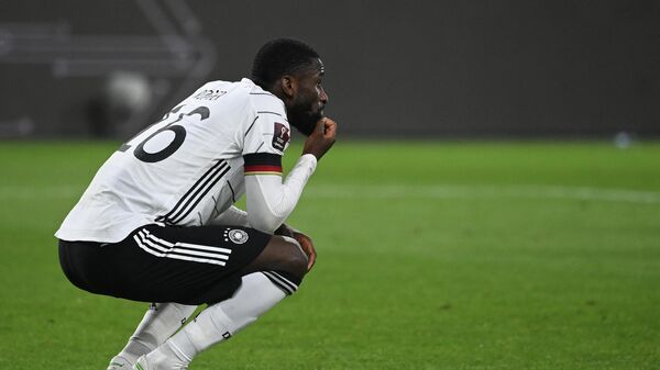 Germany's defender Antonio Ruediger reacts after the FIFA World Cup Qatar 2022 qualification football match Germany v North Macedonia in Duisburg, western Germany on March 31, 2021. (Photo by Ina Fassbender / AFP)