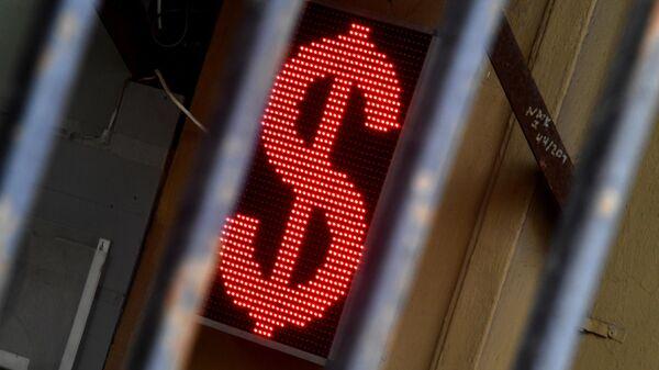 Электронное табло со знаком доллара