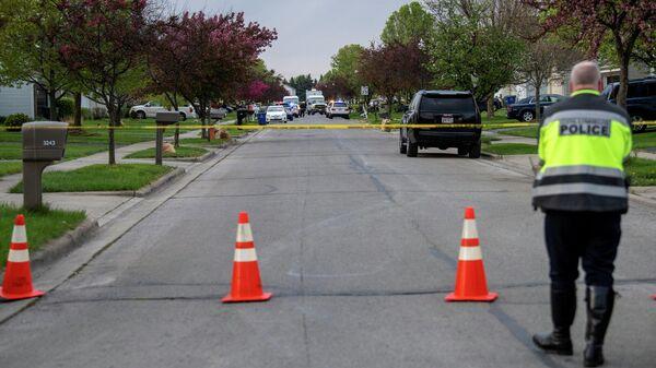 Полицейский в районе места убийства Макайи Брайант в городе Колумбус