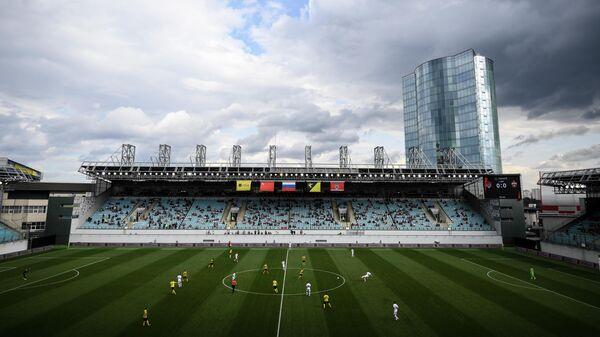 Игроки на поле стадиона Арена Химки