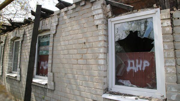 Последствия обстрела в Киевском районе Донецка