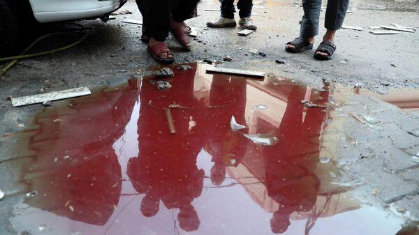 Место гибели палестинцев после израильских ударов по сектору Газа