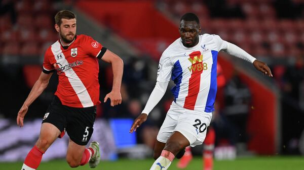 Southampton's English defender Jack Stephens (L) vies with Crystal Palace's Zaire-born Belgian striker Christian Benteke during the English Premier League football match between Southampton and Crystal Palace at St Mary's Stadium in Southampton, southern England on May 11, 2021. (Photo by DAN MULLAN / POOL / AFP) / RESTRICTED TO EDITORIAL USE. No use with unauthorized audio, video, data, fixture lists, club/league logos or 'live' services. Online in-match use limited to 120 images. An additional 40 images may be used in extra time. No video emulation. Social media in-match use limited to 120 images. An additional 40 images may be used in extra time. No use in betting publications, games or single club/league/player publications. /