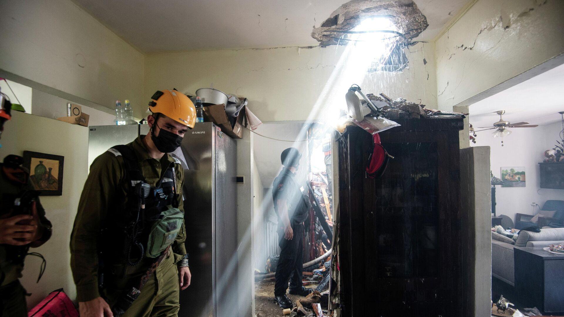 Разрушенное здание в Ашдоде, Израиль  - РИА Новости, 1920, 15.05.2021