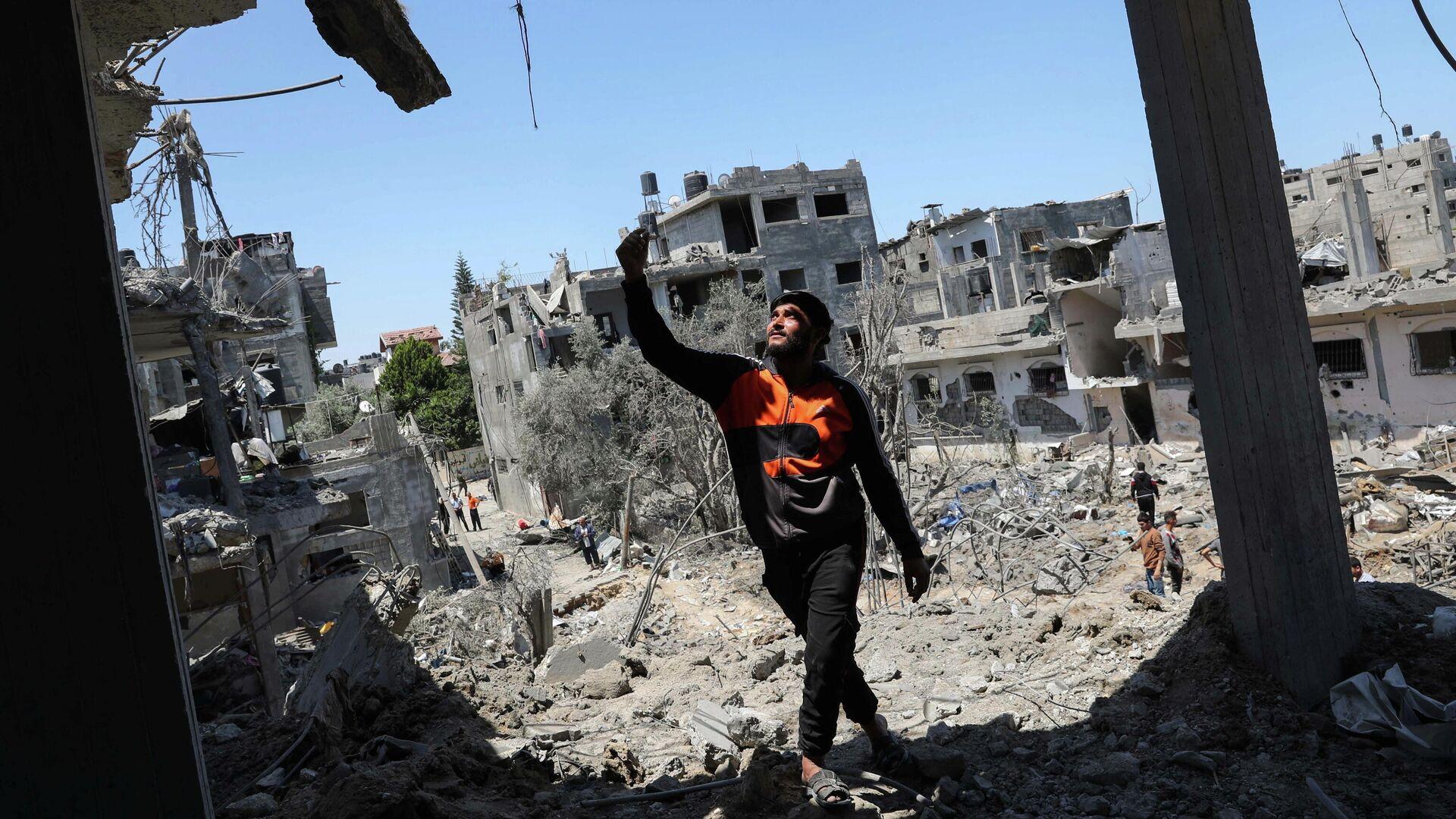 Разрушенные в результате израильских авиационных и артиллерийских ударов дома в северной части сектора Газа - РИА Новости, 1920, 14.05.2021