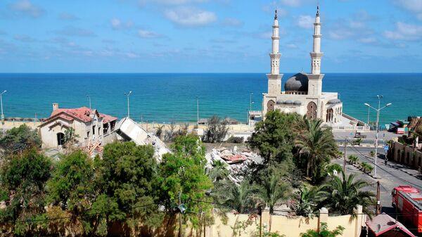Вид на разрушенные в результате бомбардировки здания в секторе Газа