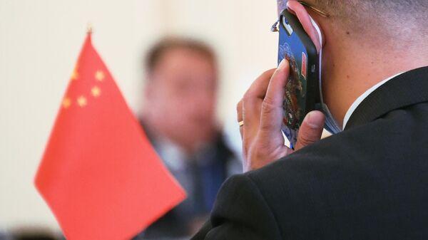 Представитель КНР во время конференции