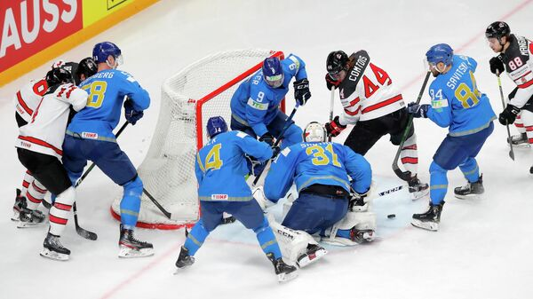 Ice Hockey - IIHF World Ice Hockey Championship 2021 - Group B - Kazakhstan v Canada - Arena Riga, Riga, Latvia - May 28, 2021 Kazakhstan's Andrei Shutov, Jesse Blacker and teammates in action with Canada's Maxime Comtois REUTERS/Vasily Fedosenko
