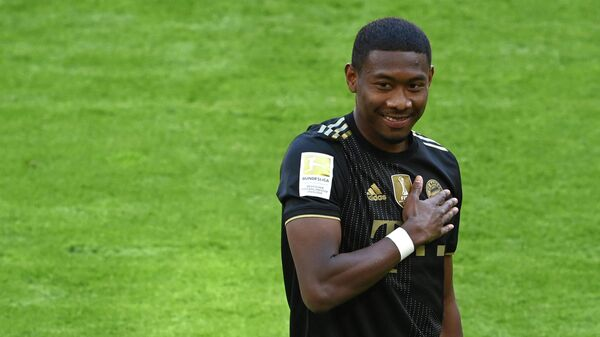 Bayern Munich's Austrian defender David Alaba gestures prior the German first division Bundesliga football match Bayern Munich vs FC Augsburg in Munich, southern Germany, on May 22, 2021. (Photo by CHRISTOF STACHE / POOL / AFP) / DFL REGULATIONS PROHIBIT ANY USE OF PHOTOGRAPHS AS IMAGE SEQUENCES AND/OR QUASI-VIDEO